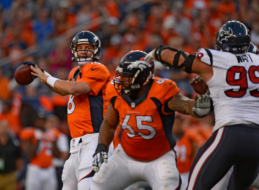 . DENVER, CO - AUGUST 23: Denver Broncos quarterback Peyton Manning (18) throws down field against the Houston Texans defense during the first quarter August 23, 2014 at Sports Authority Field at Mile High Stadium. (Photo by Kent Nishimura/The Denver Post)