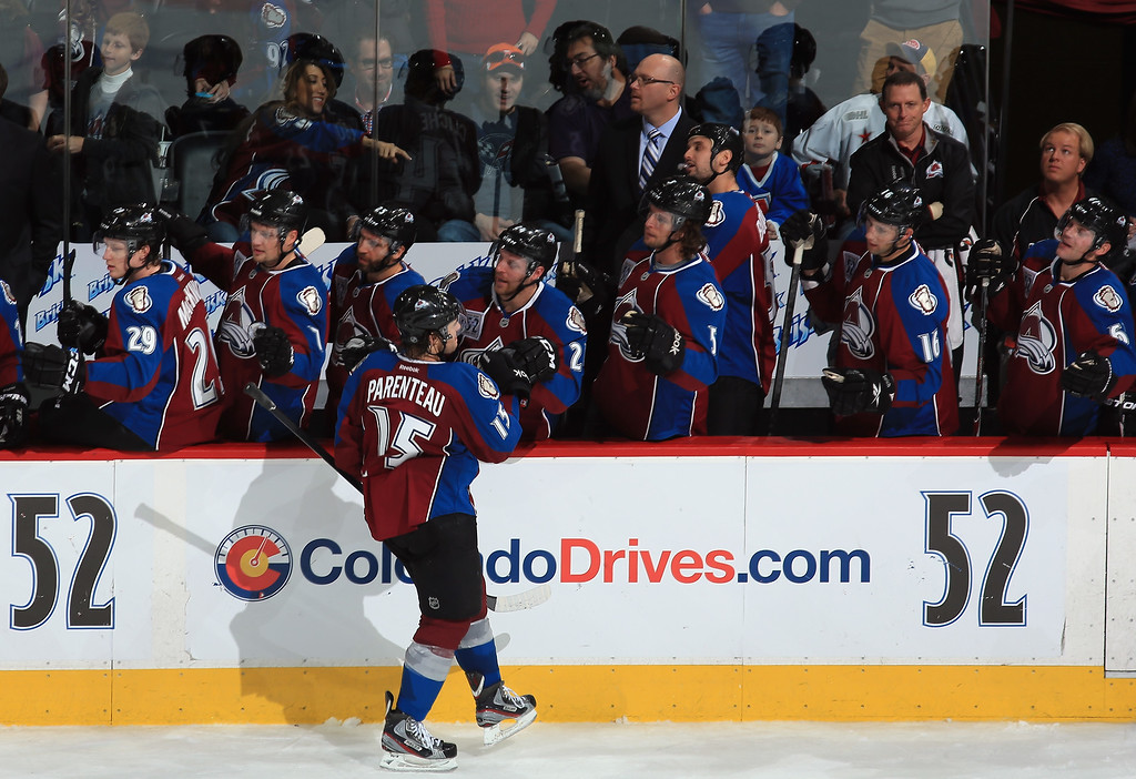 . DENVER, CO - NOVEMBER 02:  P.A. Parenteau #15 of the Colorado Avalanche celebrates his empty net goal as the Avalanche defeated the Montreal Canadiens 4-1 at Pepsi Center on November 2, 2013 in Denver, Colorado.  (Photo by Doug Pensinger/Getty Images)