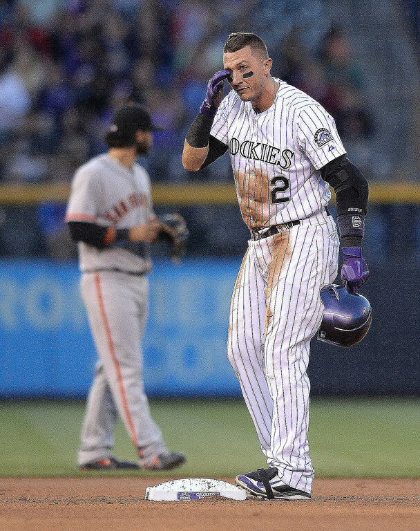 . Colorado baserunner Troy Tulowitzki got a bit of dirt in his eye after sliding safely into second base with a double in the fourth inning.  (Photo by Karl Gehring/The Denver Post)