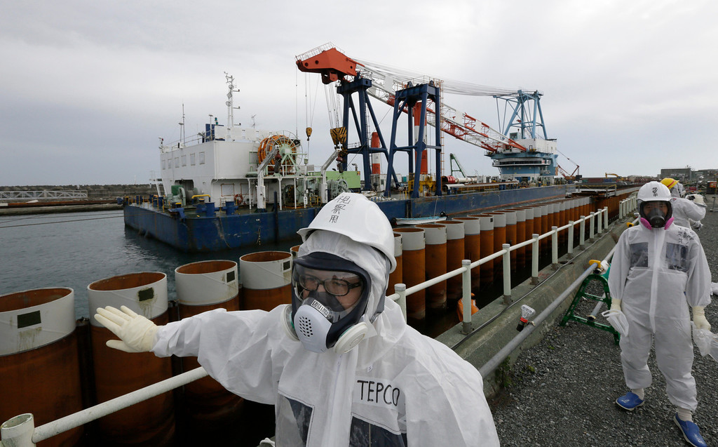 . Tokyo Electric Power Co. (Tepco) officials check a wall along the coastline at the Fukushima Dai-ichi nuclear power plant in Okuma, Fukushima Prefecture, Japan on November 7, 2013.   AFP PHOTO / POOLKIMIMASA MAYAMA/AFP/Getty Images