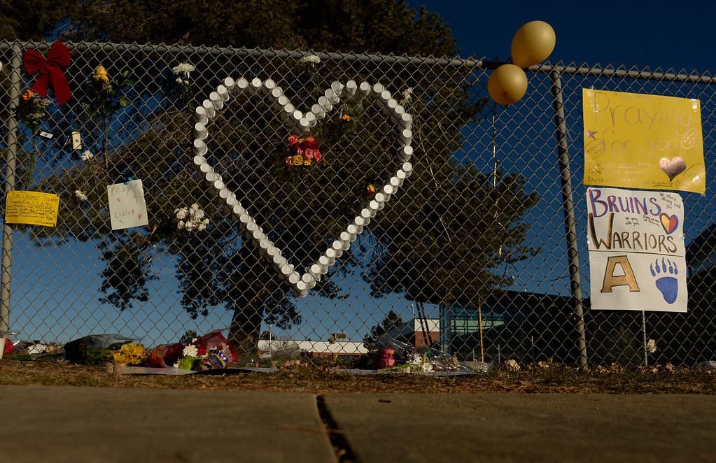 . A sign of support is woven into a fence around Arapahoe High School in Centennial, December 16, 2013. The school was the scene of a shooting on Friday that left a student gunman dead and two other students injured. (Photo by RJ Sangosti/The Denver Post)