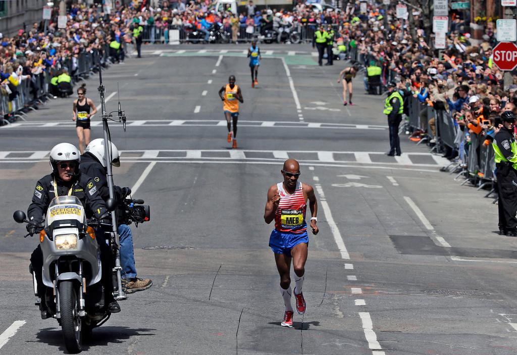 . Meb Keflezighi, of San Diego, Calif., runs the final few blocks before winning the 118th Boston Marathon Monday, April 21, 2014 in Boston. (AP Photo/Steven Senne)
