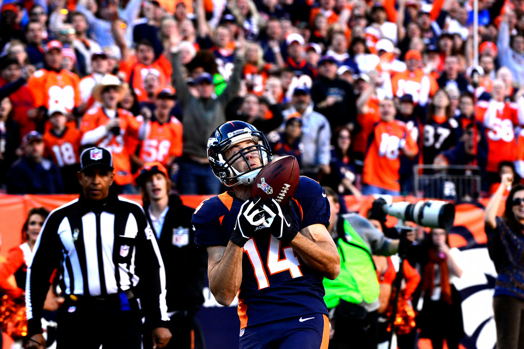 . Now-retired Brandon Stokley pulls in a touchdown pass against the Chargers. (Joe Amon, The Denver Post)