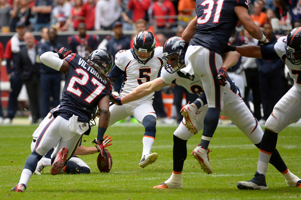 . HOUSTON, TX. - December 22: kicker Matt Prater #5 of the Denver Broncos makes the score 3-0 with 8:50 left in the first quarter as the Denver Broncos vs the Houston Texans at Reliant Stadium December 22, 2013 Houston, Texas. (Photo By Joe Amon/The Denver Post)