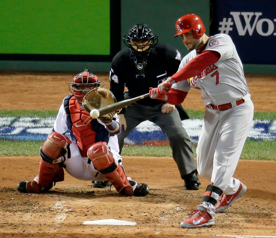 . St. Louis Cardinals\' Matt Holliday hits a triple during the fourth inning of Game 2 of baseball\'s World Series against the Boston Red Sox Thursday, Oct. 24, 2013, in Boston. (AP Photo/Charlie Riedel)