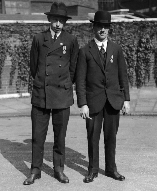 . October 1, 1915:   Leslie Martin and Joseph Parry of the \'Lusitania\' with their medals for bravery. They were decorated by the King.  (Photo by Topical Press Agency/Getty Images)