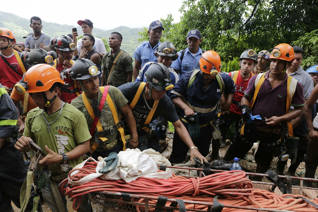 ". Miners help rescuers in their attempt to reach a group of fellow miners trapped in a gold mine in the community of El Comal, near Bonanza in northeastern Nicaragua, on August 29, 2014. At least 20 miners are trapped alive deep underground after an informal gold mine collapsed in northeastern Nicaragua, presidential spokeswoman Rosario Murillo said Friday. ""We have identified 20 comrades who are alive,\"" Murillo said, adding there were 28 miners working in the shaft 800 meters (2,600 feet) underground when the cave-in happened Thursday. Two miners have managed to dig their way out. Inti Ocon/AFP/Getty Images"