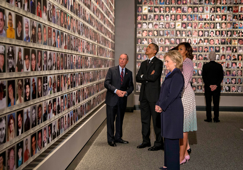 . President Barack Obama and first lady Michelle Obama, along with former Secretary of State Hillary Rodham Clinton and former President Bill Clinton tour the Memorial Hall at the National September 11 Memorial Museum with former New York Mayor Michael Bloomberg, Thursday, May 15, 2014, in New York.  (AP Photo/Carolyn Kaster)