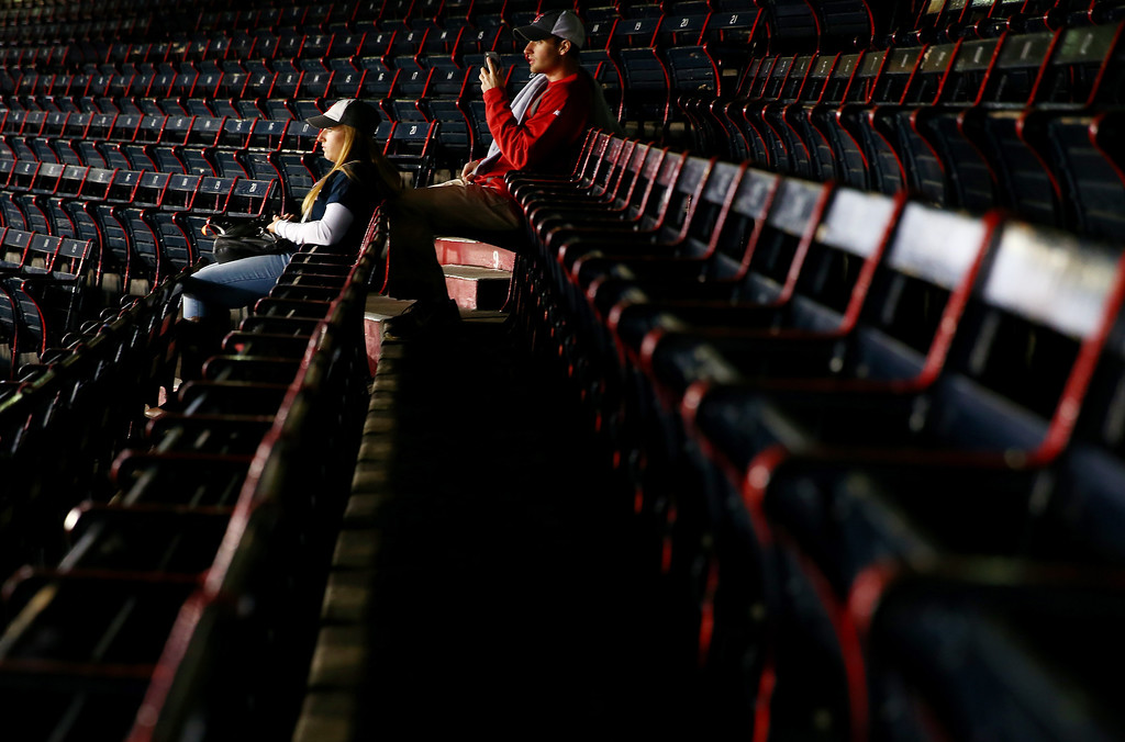. Fans sit in their seats before Game Two of the 2013 World Series between the Boston Red Sox and the St. Louis Cardinals  at Fenway Park on October 24, 2013 in Boston, Massachusetts.  (Photo by Elsa/Getty Images)