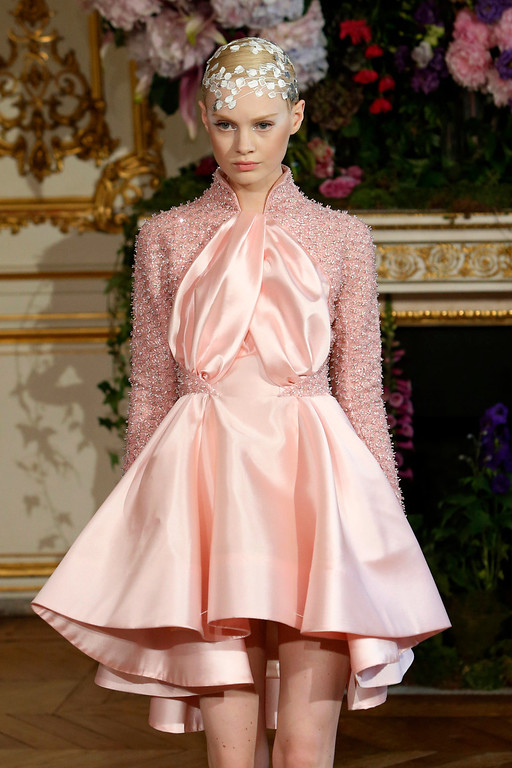 . A model wears a creation as part of Alexis Mabille\'s Haute Couture Fall-Winter 2013-2014 collection, presented Monday, July 1, 2013 in Paris. (AP Photo/Francois Mori)