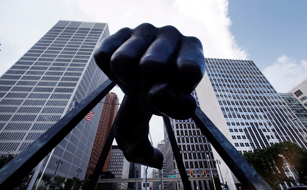 ". The Detroit skyline rises behind the Monument to Joe Louis, also known as ""The Fist,\"" Thursday, July 18, 2013. State-appointed emergency manager Kevyn Orr asked a federal judge permission to place Detroit into Chapter 9 bankruptcy protection. (AP Photo/Paul Sancya)"