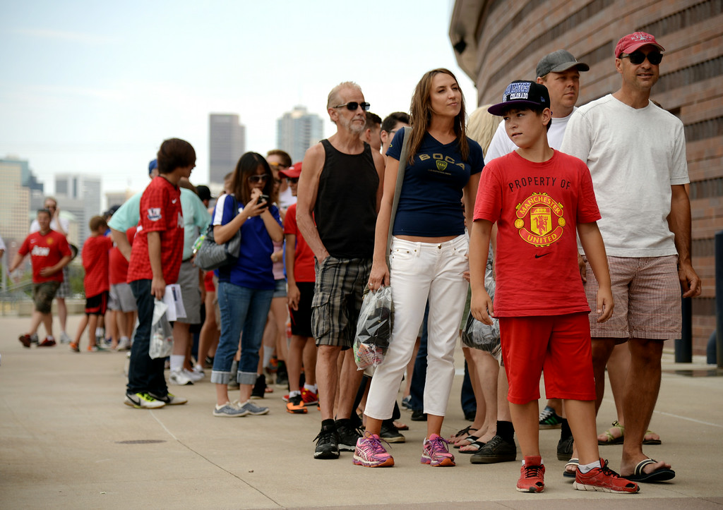 . Jacob Bender, 11, of Parker, front, and soccer fans are in Sports Authority Field at Mile High for Manchester United vs. AS Roma Guinness International Champions Cup 2014. Denver, Colorado. July 26. 2014. (Photo by Hyoung Chang/The Denver Post)
