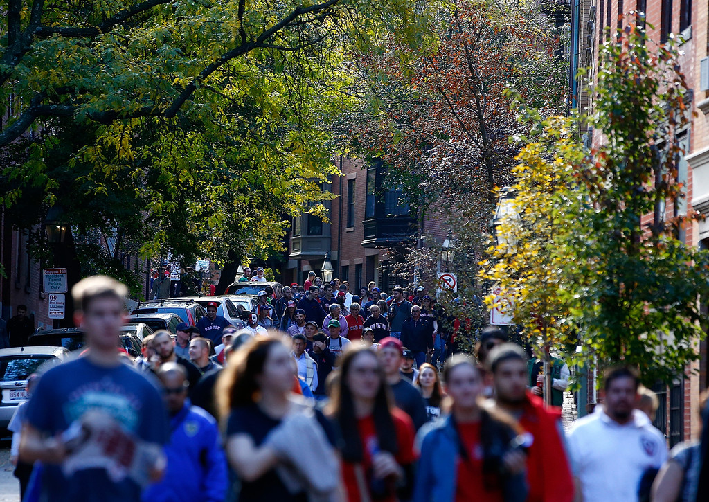 . BOSTON, MA - NOVEMBER 02: Fans make their way down side streets in the Back Bay section of Boston during the World Series victory parade on November 2, 2013 in Boston, Massachusetts.  (Photo by Jared Wickerham/Getty Images)