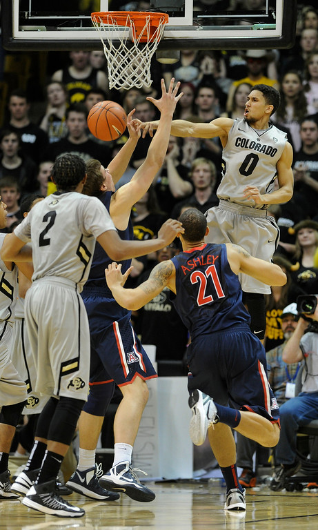 . BOULDER, CO. - FEBRUARY 14: Colorado Buffaloes guard Askia Booker (0) blocked a shot in the second half. The University of Colorado men\'s basketball team defeated Arizona 71-58 Thursday night, February 14, 2013 at the Coors Event Center in Boulder. (Photo By Karl Gehring/The Denver Post)