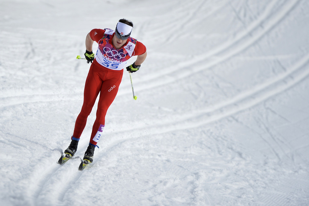 . Switzerland\'s Dario Cologna competes to win gold in the Men\'s Cross-Country Skiing 15km Classic at the Laura Cross-Country Ski and Biathlon Center during the Sochi Winter Olympics on February 14, 2014 in Rosa Khutor near Sochi.  AFP PHOTO / ODD ANDERSEN/AFP/Getty Images