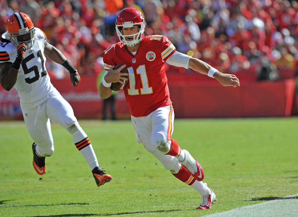 . Quarterback Alex Smith #11 of the Kansas City Chiefs rushes up the sideline for a first down past linebacker Barkevious Mingo #51 of the Cleveland Browns during the first half on October 27, 2013 at Arrowhead Stadium in Kansas City, Missouri. (Photo by Peter Aiken/Getty Images)