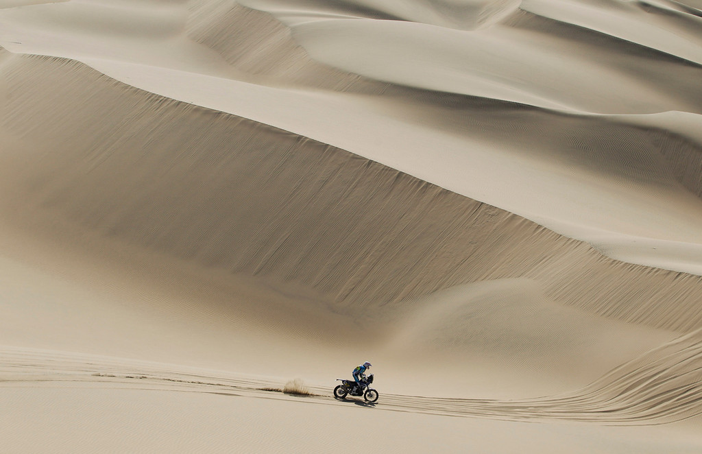 . Yamaha rider Michael Metge of France races during the 3nd stage of the 2013 Dakar Rally from Pisco to Nazca, Peru, Monday, Jan. 7, 2013. The race finishes in Santiago, Chile, on Jan. 20. (AP Photo/Victor R. Caivano)
