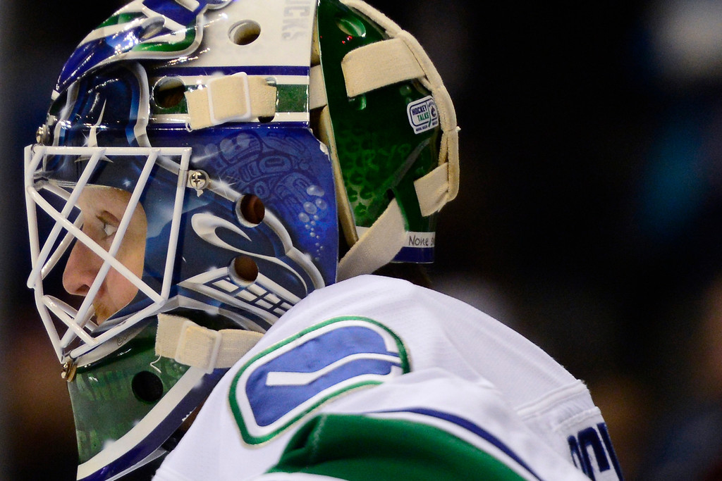 . DENVER, CO - MARCH 24: Cory Schneider (35) of the Vancouver Canucks reacts to giving up a goal to Jamie McGinn (11) of the Colorado Avalanche during the first period of action. Colorado Avalanche versus the Vancouver Canucks at the Pepsi Center. (Photo by AAron Ontiveroz/The Denver Post)