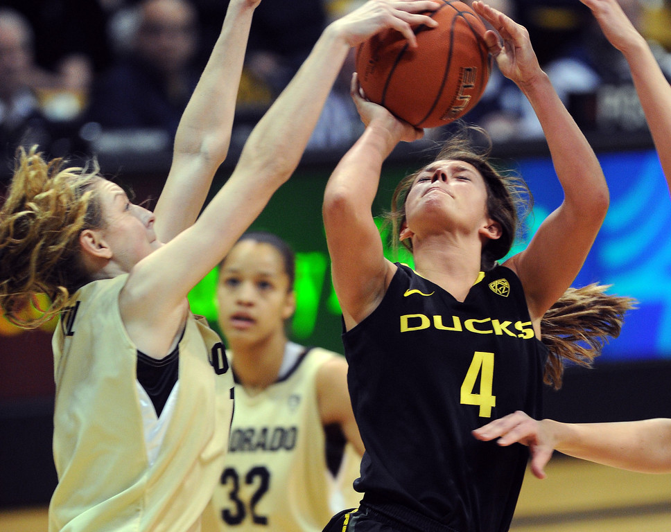 . Lexy Kresl of CU, blocks the shot of Devyn Galland of Oregon. Cliff Grassmick / February 10, 2013