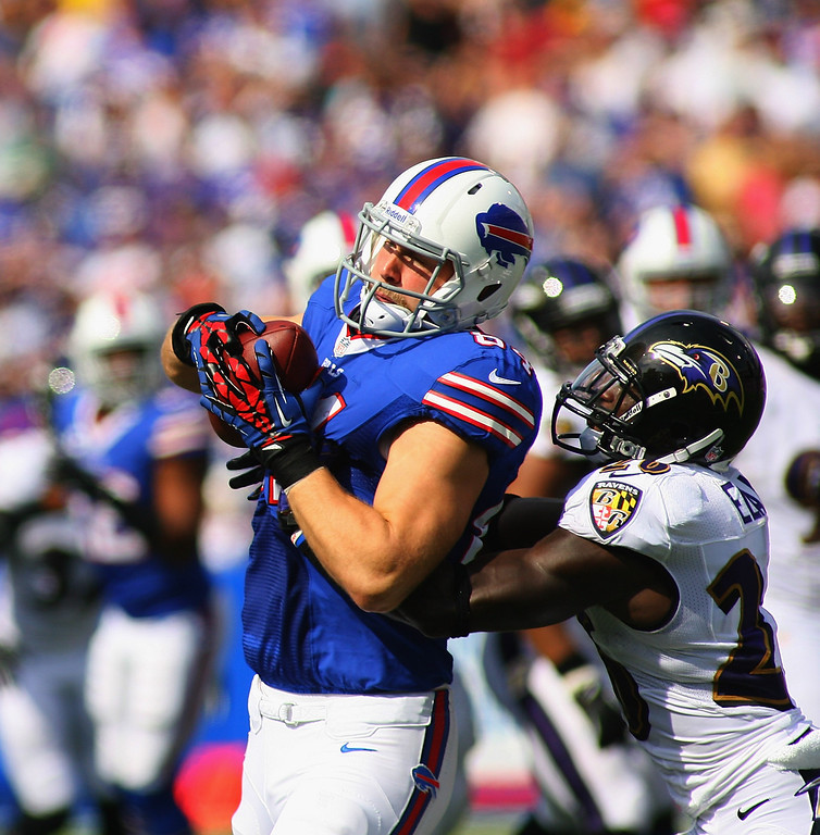 . ORCHARD PARK, NY - SEPTEMBER 29:  Scott Chandler #84 of the Buffalo Bills makes a catch against  Matt Elam #26 of the Baltimore Ravens at Ralph Wilson Stadium on September 29, 2013 in Orchard Park, New York.  (Photo by Rick Stewart/Getty Images)