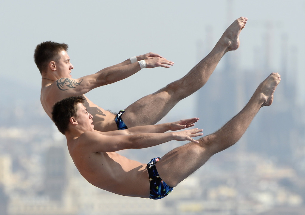 . Russia\'s Artem Chesakov and Victor Minibaev compete in the men\'s 10-metre synchro platform preliminary diving event in the FINA World Championships at the Piscina   LLUIS GENE/AFP/Getty Images