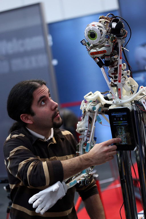 . Technician Cyril Jourdan looks at a human robot at the booth of Maxon Motor\'s at the industrial trade fair in Hanover, central Germany on April 8, 2013. The fair running from April 8 to 12, 2013 will present a cross section of key industrial technologies.   RONNY HARTMANN/AFP/Getty Images