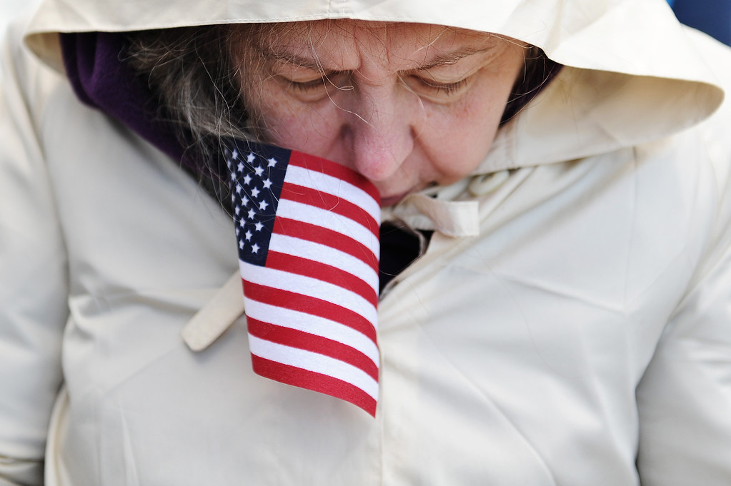 . A visitor reads Dedication Day literature during a commemoration of the 150th Anniversary of the Gettysburg Address at the Soldiers\' National Cemetery at Gettysburg National Military Park on November 19, 2013 in Gettysburg, Pennsylvania. (Photo by Patrick Smith/Getty Images)