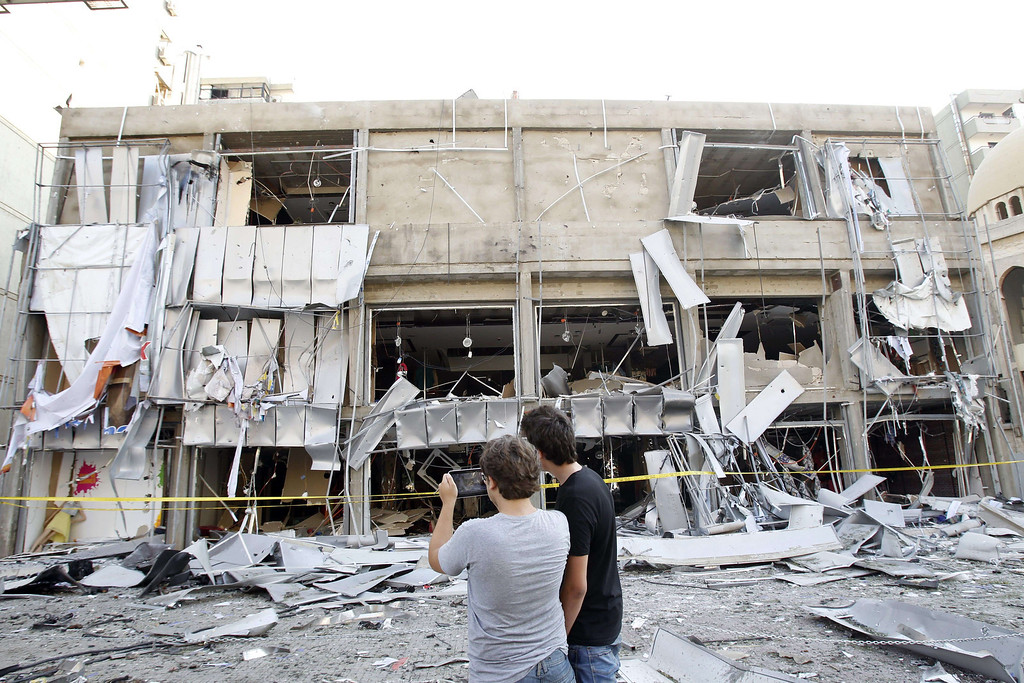 . Lebanese civilians take a picture of the site of the blast outside the Al-Salam mosque (background) in the northern city of Tripoli on August 23, 2013. AFP PHOTO/ANWAR  AMRO/AFP/Getty Images