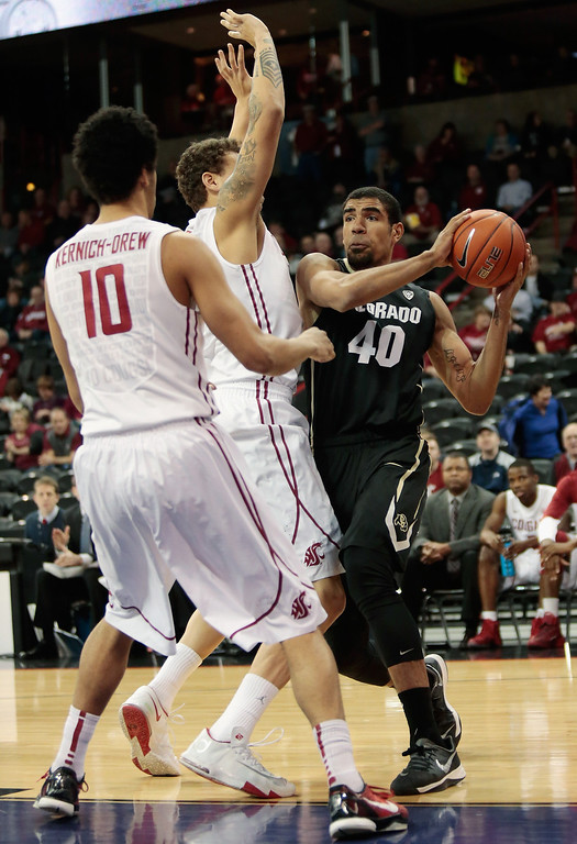 . Jordan Railey #20 of the Washington State Cougars applies pressure on Josh Scott #40 of the Colorado Buffaloes as he looks to pass around Dexter Kernich-Drew #10 during the game at Spokane Arena on January 8, 2014 in Spokane, Washington.  (Photo by William Mancebo/Getty Images)