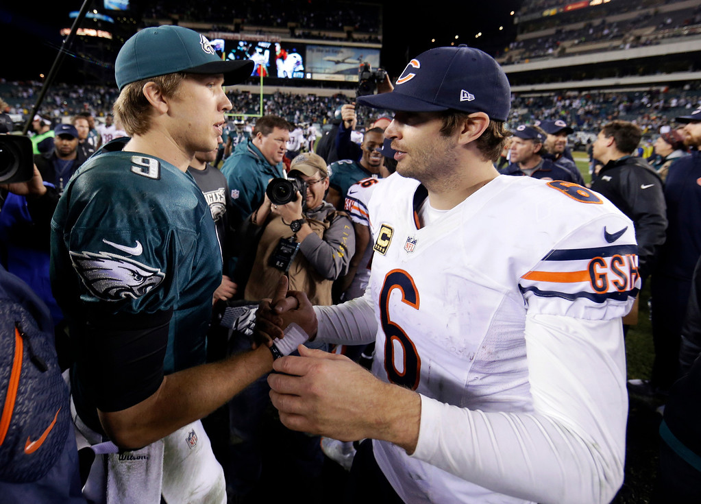 . Chicago Bears\' Jay Cutler, right, meets with Philadelphia Eagles\' Nick Foles after an NFL football game, Sunday, Dec. 22, 2013, in Philadelphia. Philadelphia won 54-11. (AP Photo/Matt Rourke)