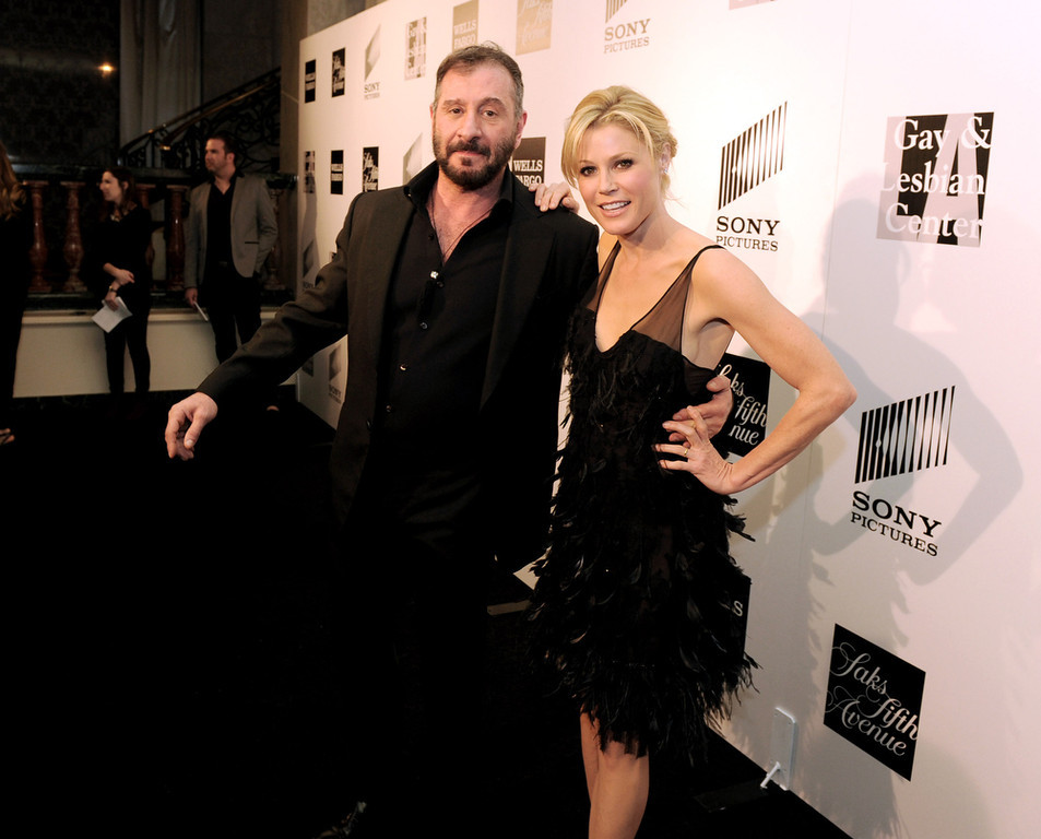 """. Honoree fashion designer Ralph Rucci (L) and actress Julie Bowen arrive at \""""An Evening\"""" benifiting The L.A. Gay & Lesbian Center at the Beverly Wilshire Hotel on March 21, 2013 in Beverly Hills, California.  (Photo by Kevin Winter/Getty Images)"""