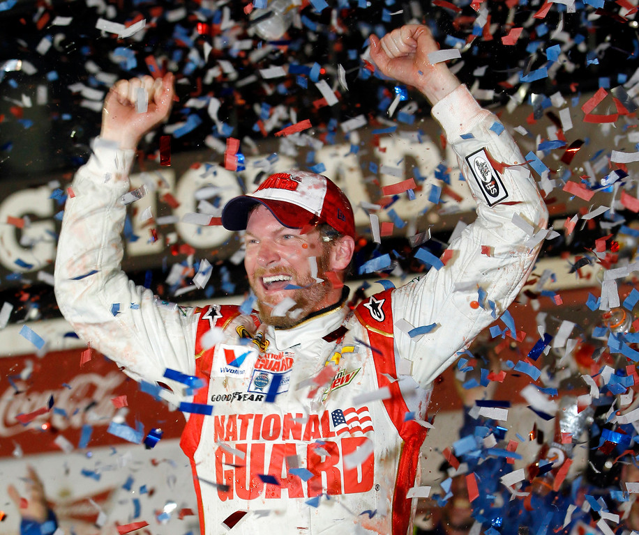 . Dale Earnhardt Jr. celebrates in Victory Lane after winning the NASCAR Daytona 500 Sprint Cup series auto race at Daytona International Speedway in Daytona Beach, Fla., Sunday, Feb. 23, 2014. (AP Photo/Terry Renna)