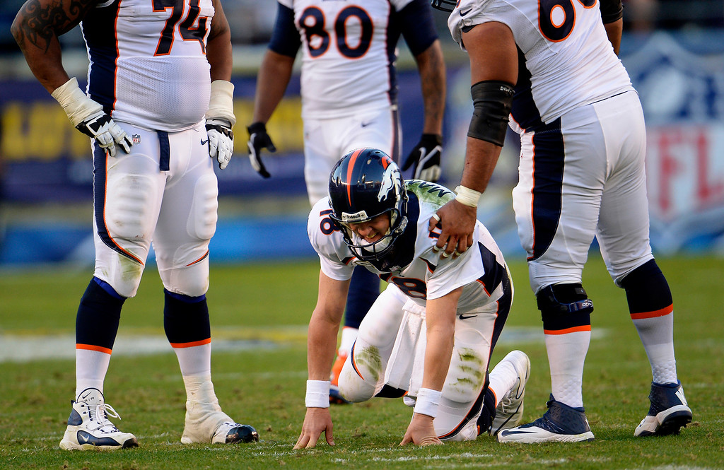 . Quarterback Peyton Manning #18 of the Denver Broncos is slow to get up after being injured during the fourth quarter against the San Diego Chargers at Qualcomm Stadium on Sunday, November 10, 2013, in San Diego, California. Manning is scheduled to get an MRI on Monday to determine the severity of the injuury.  (Photo By Joe Amon/The Denver Post)