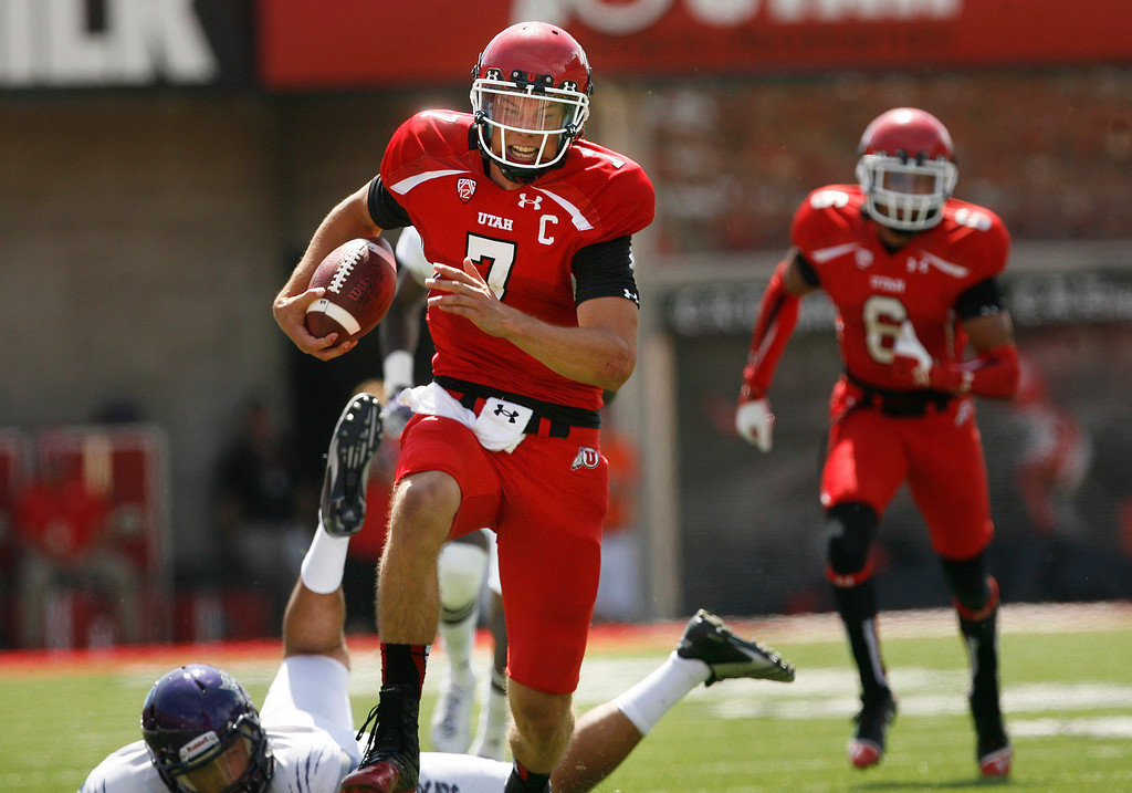 . Utah quarterback Travis Wilson (7) runs for a 51-yard touchdown against Weber State during an NCAA college football game on Saturday, Sept. 7, 2013 in Salt Lake City.  Utah defeated Weber State 70-7.  (AP Photo/The Salt Lake Tribune, Scott Sommerdorf)