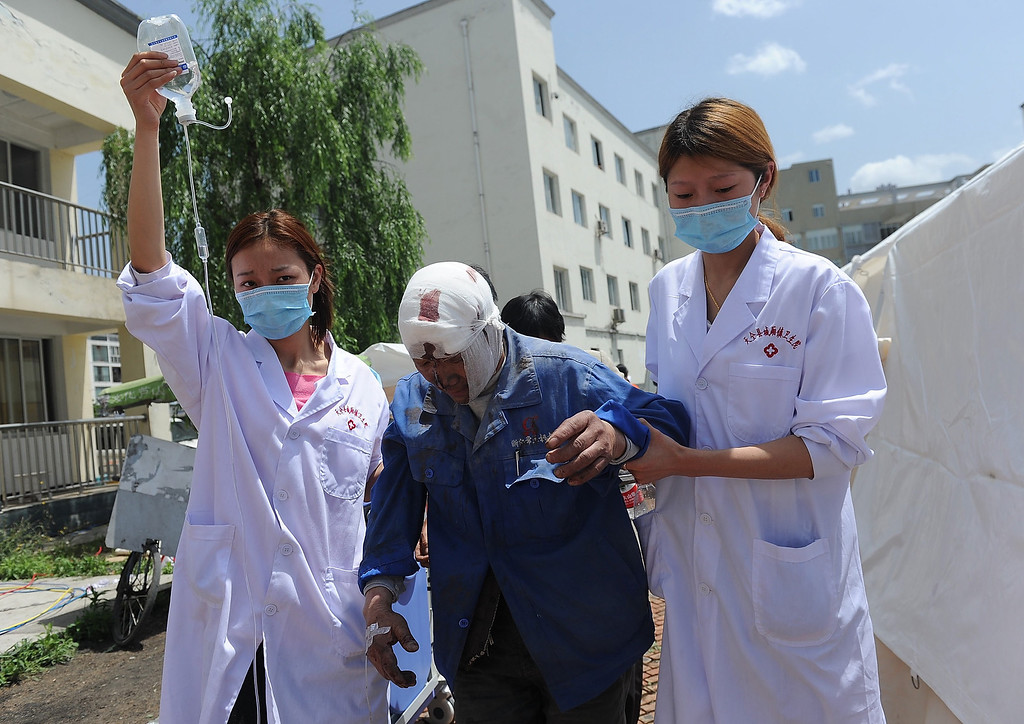 . Nurses help an injured man at a temporary treatment station following an earthquake in Lushan county in Ya\'an in southwest China\'s Sichuan province Saturday, April 20, 2013. The powerful earthquake shook Chinaís Sichuan province Saturday morning, nearly five years after a devastating quake jolted the province. (AP Photo)
