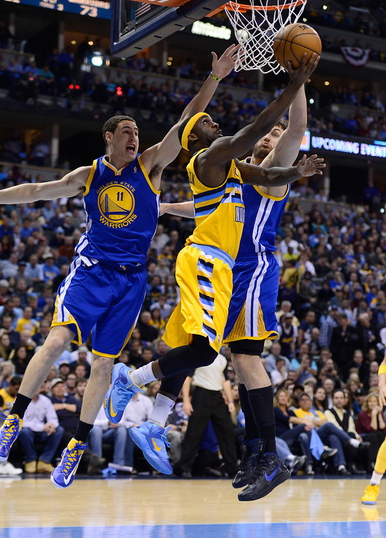 . DENVER, CO. - APRIL 23: Denver Nuggets point guard Ty Lawson (3) puts up a shot against Golden State Warriors shooting guard Klay Thompson (11) and Golden State Warriors center Andrew Bogut (12) in the third quarter. The Denver Nuggets took on the Golden State Warriors in Game 2 of the Western Conference First Round Series at the Pepsi Center in Denver, Colo. on April 23, 2013. (Photo by AAron Ontiveroz/The Denver Post)