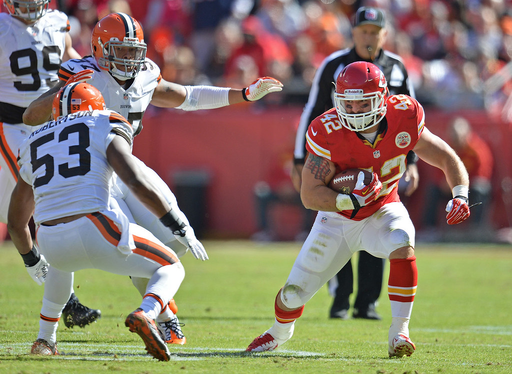 . Running back Anthony Sherman #42 of the Kansas City Chiefs rushes against pressure from linebacker Graig Robertson #53 of the Cleveland Browns during the first half on October 27, 2013 at Arrowhead Stadium in Kansas City, Missouri. Kansas City won 23-17. (Photo by Peter Aiken/Getty Images)