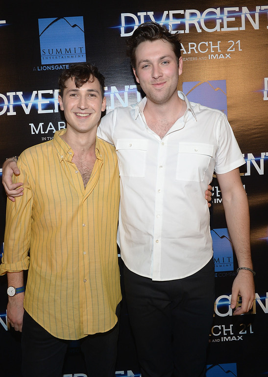 . Ben Lloyd-Hughes and Christian Madsen attends the Divergent Local Premiere In Miami at AMC Sunset Place on March 5, 2014 in Miami, Florida.  (Photo by Gustavo Caballero/Getty Images for Allied THA)