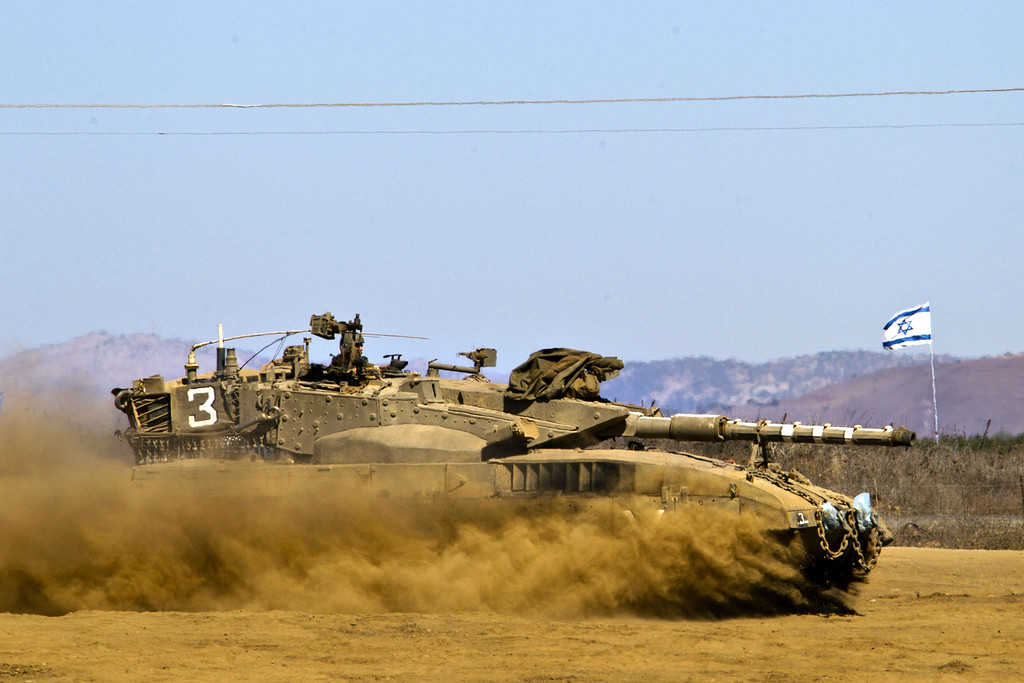 . An Israeli soldier sits at the top a Merkava tank as it rolls in a training field in the Golan Heights, next to the Israeli-Syrian border, on October 10, 2013. The Israeli army fired on October 9, a Tammuz missile across the Syrian border in response to mortar fire from the Syrian at an Israeli military base in the northern Israeli-annexed Golan Heights leaving two soldiers with light wounds.  JACK GUEZ/AFP/Getty Images