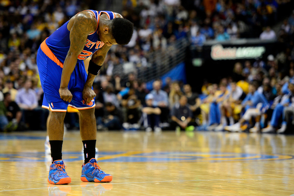 . DENVER, CO - MARCH 13: Iman Shumpert (21) of the New York Knicks hangs his head during the second half of of the Nuggets\' win. The Denver Nuggets play the New York Knicks at the Pepsi Center. (Photo by AAron Ontiveroz/The Denver Post)