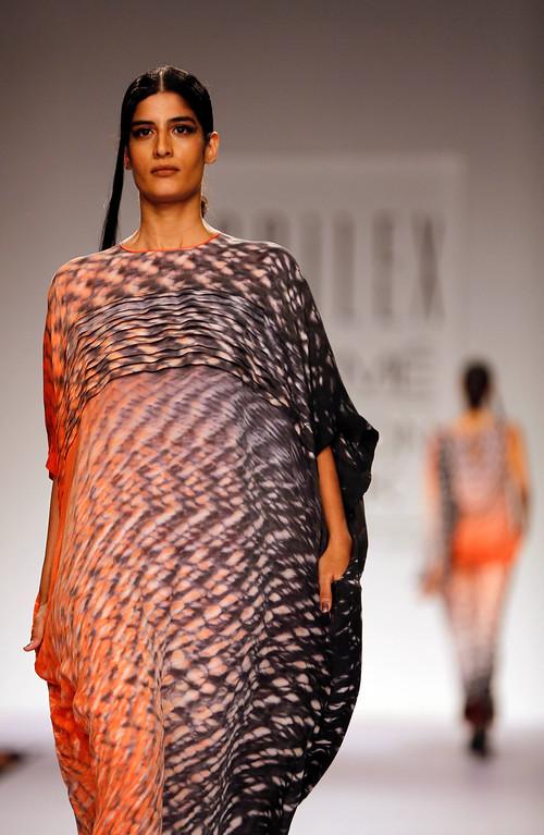 . Models walk the runway to showcase creations by Sailex during the Lakme Fashion Week in Mumbai, India, Thursday, March 13, 2013. (AP Photo/Rajanish Kakade)