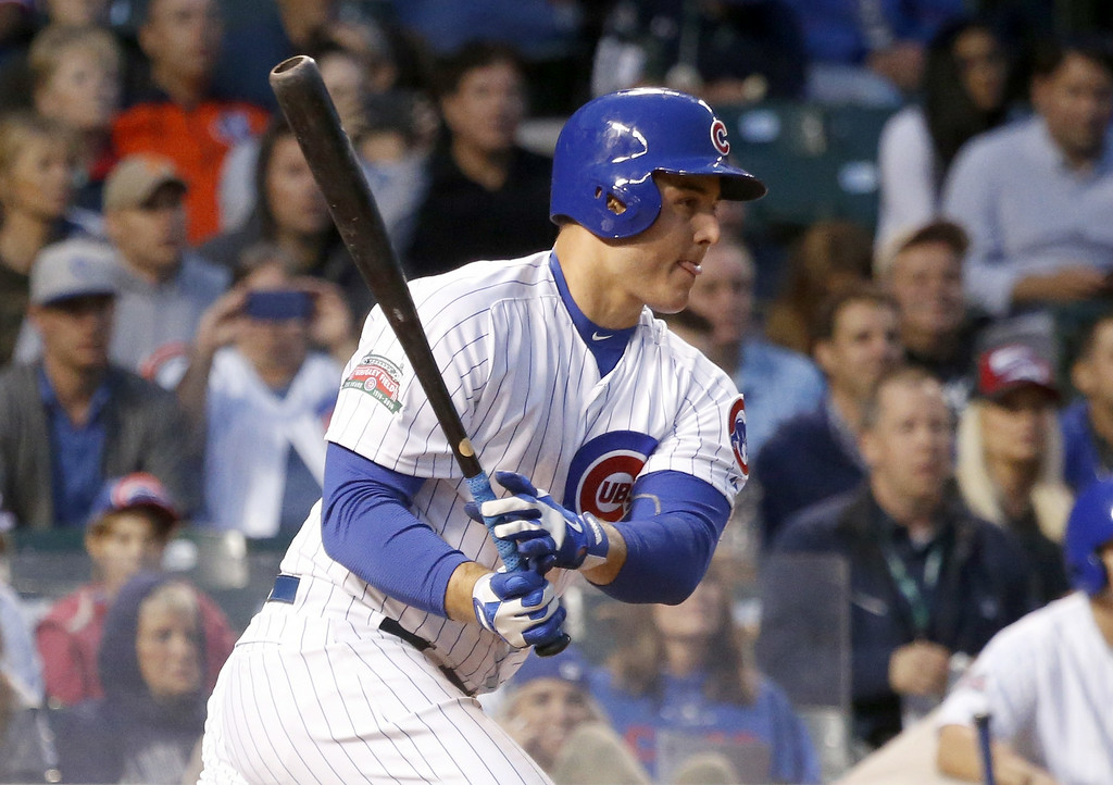 . Chicago Cubs\' Anthony Rizzo grounds out to Colorado Rockies second baseman DJ LeMahieu during the fourth inning of a baseball game Monday, July 28, 2014, in Chicago. Emilio Bonifacio scored on the play (AP Photo/Charles Rex Arbogast)