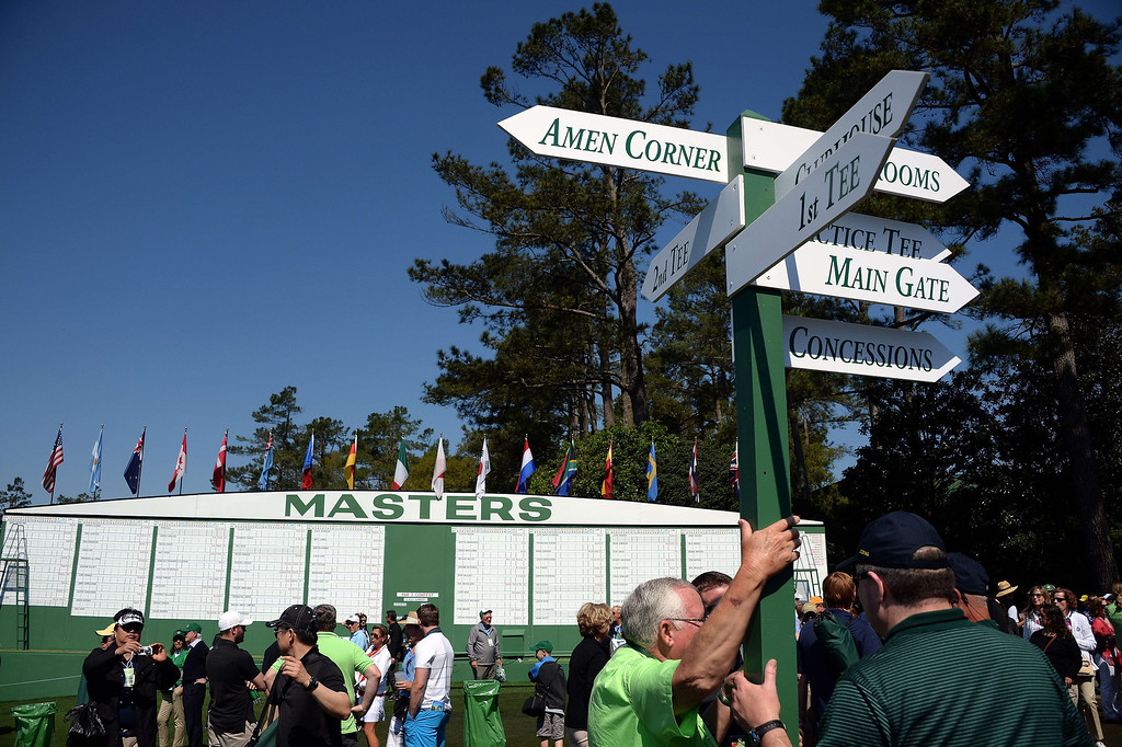 . Patrons make their way past the main leader board during a practice round prior the start of the 78th Masters Golf Tournament at Augusta National Golf Club on April 9, 2014 in Augusta, Georgia. Augusta National\'s trademark back-nine drama in the final round of the Masters could reach epic heights Sunday with a field that offers no clear favorite and several rising young stars.   JIM WATSON/AFP/Getty Images