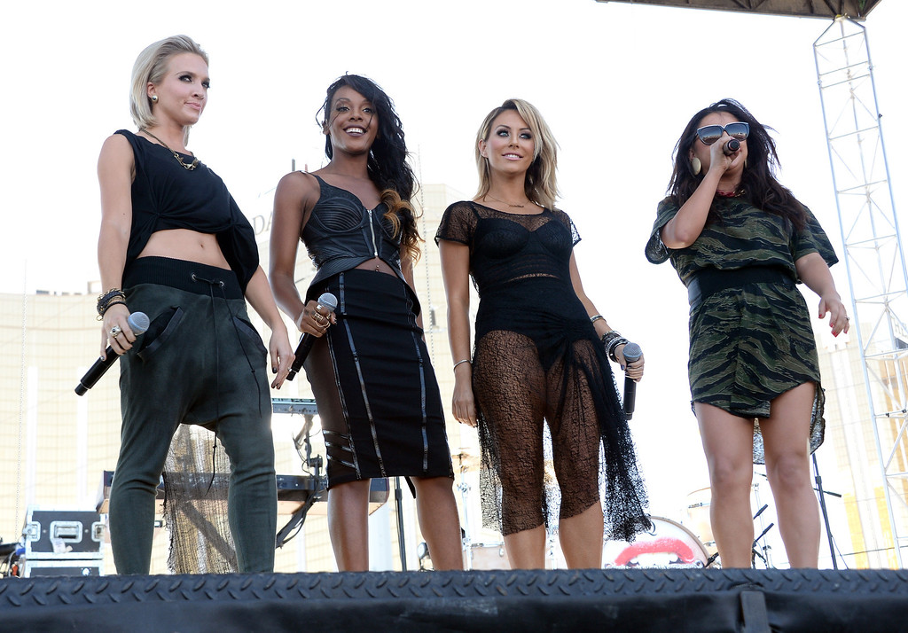 . Shannon Bex, Dawn Richards, Aubrey O\'Day and Andrea Fimbres of Danity Kane perform onstage during the iHeart Radio Music Festival Village on September 21, 2013 in Las Vegas, Nevada.  (Photo by Jason Kempin/Getty Images for Clear Channel)