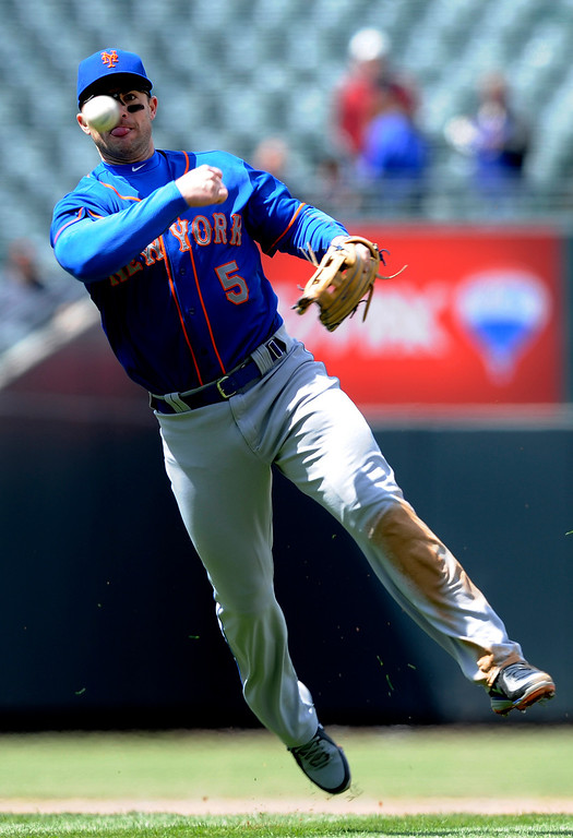 . New York Mets third baseman David Wright throws out Colorado Rockies\' Todd Helton at first during the second inning of a baseball game on Thursday, April 18, 2013, in Denver. (AP Photo/Jack Dempsey)
