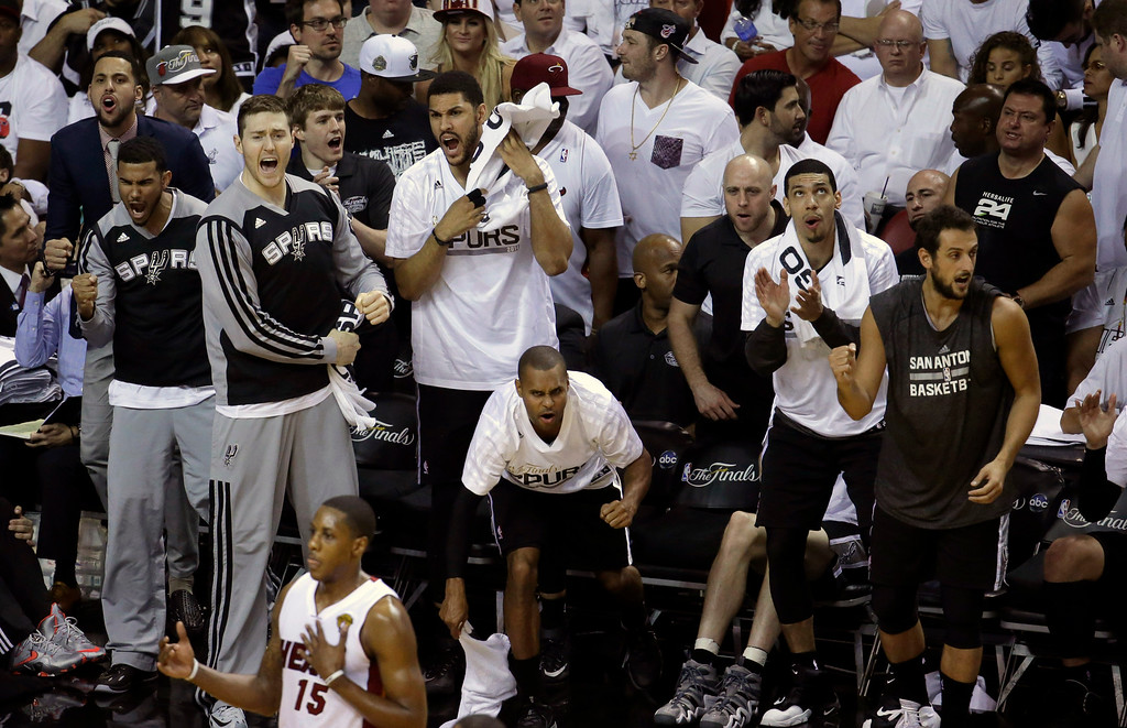 . San Antonio Spurs players cheer on their team from the bench in the second half in Game 4 of the NBA basketball finals against the Miami Heat, Thursday, June 12, 2014, in Miami. (AP Photo/Wilfredo Lee)