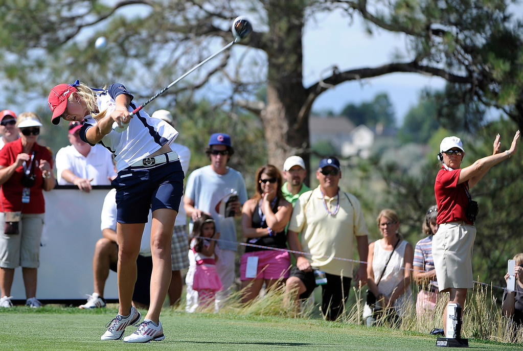 . PARKER, CO - Aug.17: Team USA\'s Jessica Korda tees off with fans watching from close behind. The 2013 Solheim Cup takes place at the Colorado Golf Club with the USA taking on Europe in the Saturday morning Foursomes Match. (Photo By Kathryn Scott Osler/The Denver Post)